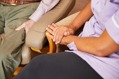 Client and carer hands photo