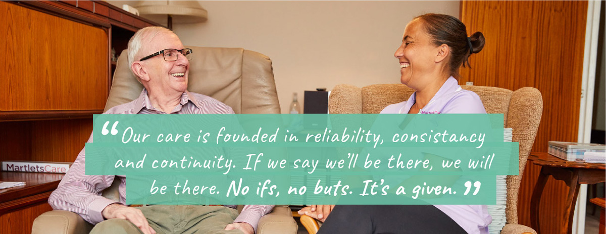Client and carer laughing together